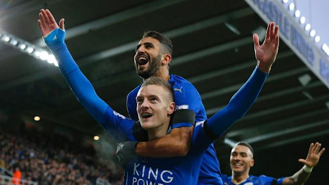 Leicester City's Jamie Vardy (front) celebrates with teammates after scoring a goal during an English Premier League match at Newcastle