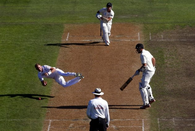 England's Broad dives as he drops a catch from New Zealand's Rutherford during the second day of the first test at the University Oval in Dunedin