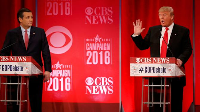 Republican U.S. presidential candidate Cruz listens to rival candidate Trump at the Republican U.S. presidential candidates debate sponsored by CBS News and the Republican National Committee in Greenville
