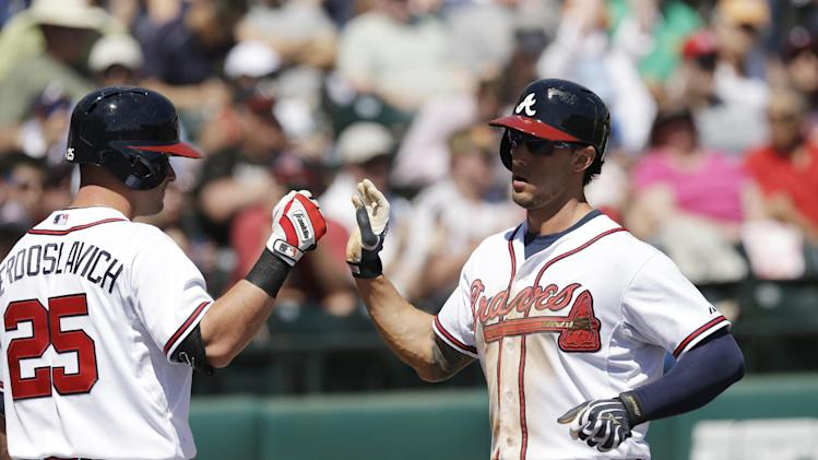 Atlanta Braves' Jordan Schafer, right, is congratulated by Joey Terdoslavich after scoring from second on a Jason Heyward single during the fifth inning of a spring exhibition baseball game against the Tampa Bay Rays in Kissimmee, Fla., Friday, March 14, 2014
