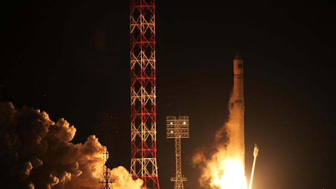 FILE - In this Wednesday, Nov. 9, 2011 file photo the Zenit-2SB rocket with the Phobos-Ground probe blasts off from its launch pad at the Cosmodrome  Baikonur, Kazakhstan. The head of Russia's space agency Roscosmos Vladimir Popovkin said Tuesday, Jan. 31, 2012, cosmic radiation was the most likely cause of the failure of a Mars moon probe that crashed to Earth this month. (AP Photo/Russian Roscosmos space agency, File)