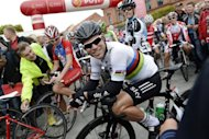 World championship road race takes centre stage on the roads around Valkenburg on Sunday. Defending champion Mark Cavendish (pictured in August) is being given little chance of retaining the rainbow jersey, while Britain's team come into the race with little left in the tank and Tour de France champion Bradley Wiggins and runner-up Chris Froome feeling the effects of an exhausting season