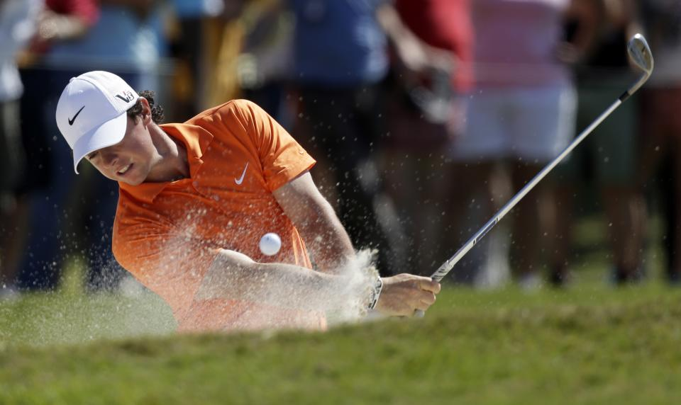 Rory McIlroy of Northern Ireland, hits from a 5th hole bunker during the second round of the Cadillac Championship golf tournament Friday, March 8, 2013, in Doral, Fla. (AP Photo/Wilfredo Lee)