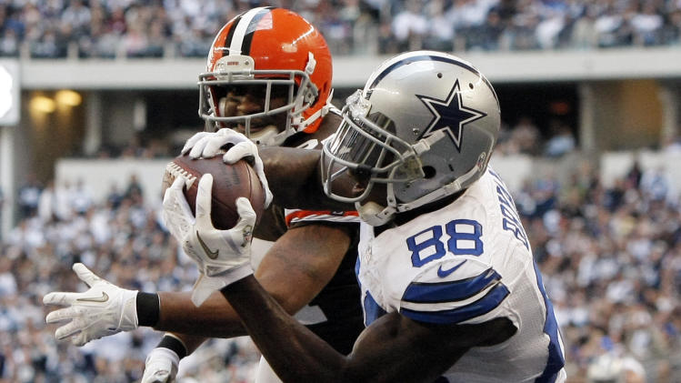 Dallas Cowboys wide receiver Dez Bryant (88) grabs a touchdown catch in front of Cleveland Browns' Sheldon Brown, rear, in the second half of an NFL football game, Sunday, Nov. 18, 2012, in Arlington, Texas. (AP Photo/Brandon Wade)