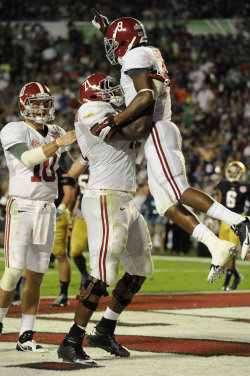 Crimson Tide wide receiver Amari Cooper celebrates his touchdown catch. (USA Today Sports)