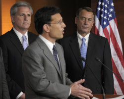 House Speaker John Boehner of Ohio, right, and House Majority Whip Kevin McCarthy of Calif., left, listen as House Majority Leader Eric Cantor of Va., center, speaks during a news conference on Capitol Hill in Washington, Thursday, July 28, 2011. (AP Photo/Susan Walsh)