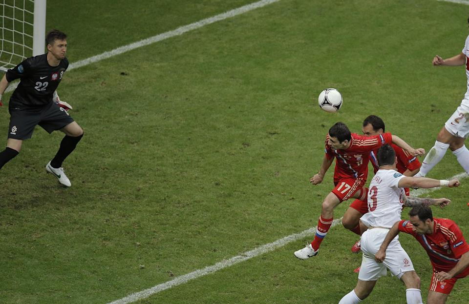 Russia's Alan Dzagoyev scores the opening goal during the Euro 2012 soccer championship Group A match between Poland and Russia in Warsaw, Poland, Tuesday, June 12, 2012. (AP Photo/Gero Breloer)
