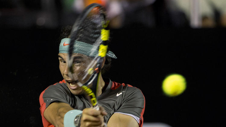 Rafael Nadal of Spain returns the ball to Daniel Gimeno-Traver of Spain at the Rio Open tennis tournament in Rio de Janeiro, Brazil, Tuesday, Feb. 18, 2014. (AP Photo/Silvia Izquierdo)