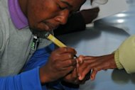 A Basotho voter is marked with indellible ink after voting at a polling station on the outskirts of Maseru. Lesotho counted ballots Saturday after a tight general election -- dominated by personal clashes rather than concerns over poverty -- that could produce the southern African nation&#39;s first coalition government