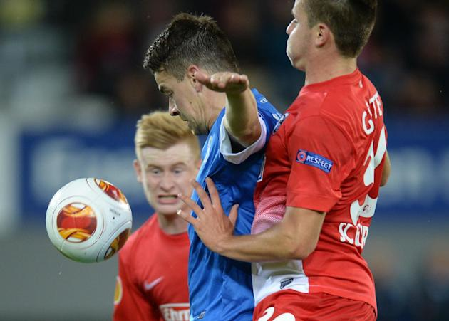 Sebastian Kerk, left, and Christian Guenter , right, of  Freiburg and Ondrej Kusnir , center, of Liberec challenge  for the ball during the UEFA Europa League Group H soccer match between SC Freiburg