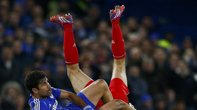 Chelsea's Costa challenges Liverpool's Gerrard during their English League Cup semi-final second leg soccer match in London