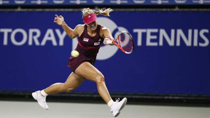 Kerber of Germany returns a shot to Cibulkova of Slovakia during their Pan Pacific Open women's singles tennis match in Tokyo