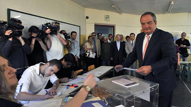 Former conservative Prime Minister Costas Karamanlis casts his ballot in Thessaloniki, northern Greece Sunday May 6, 2012. Greeks cast ballots on Sunday in their most critical _ and uncertain _ election in decades, with voters set to punish the two main parties that are being held responsible for the country's dire economic straits.  (AP Photo/Giorgos Nissiotis)