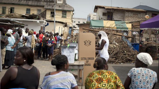 A woman casts her vote for president at a polling station in Accra, Ghana, Friday, Dec. 7, 2012. Ghanaians went to the polls Friday to choose between four candidates, including President John Dramani Mahama, who inherited the top post in July after President John Atta Mills died in office, and Nana Akufo-Addo, who lost the presidency by less than one percent to Mills in 2008. With its coup era over and five peaceful elections under its belt, Ghana is expected to hold a peaceful poll as voters decide which candidate will ensure the country's new-found wealth reaches the poor and middle-class. (AP Photo/Gabriela Barnuevo)