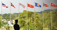 Flags of Southeast Asian Nations member countries, shown in Brunei in July 2013. Myanmar begins its first international political role in decades this week as host of Southeast Asia's regional bloc