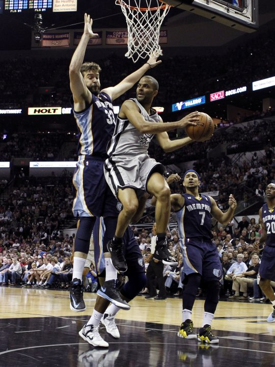 San Antonio Spurs guard Parker looks to pass as he is defended by Memphis Grizzlies center Gasol as guard Bayless watches during the first half of Game 1 of their NBA Western Conference final playoff 