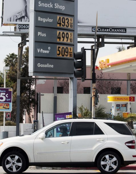 Prices rise above $5 for a gallon of premium gas at a Shell station at Olympic Boulevard and Fairfax Avenue in Los Angeles, California