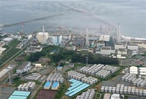 File photo of an aerial view showing TEPCO's tsunami-crippled Fukushima Daiichi nuclear power plant and its contaminated water storage tanks in Fukushima