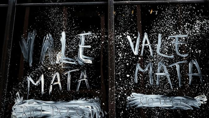 """Vale kills,"" reads a slogan smeared on the mining company's headquarters in Rio de Janeiro on November 16, 2015, as Brazilians protested in the aftermath of a November 5 dam rupture that drowned a Minas Gerais village in mud"