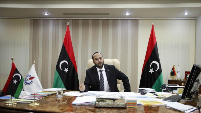 Mashallah Zwai, Oil Minister in rival Prime Minister Omar al-Hassi's government, speaks during an interview with Reuters in Tripoli