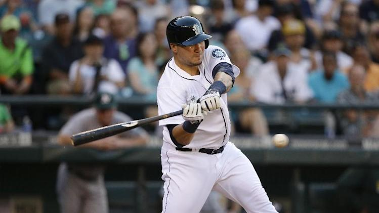 Seattle Mariners' Jesus Sucre in action against the Oakland Athletics in a baseball game Saturday, July 12, 2014, in Seattle. (AP Photo/Elaine Thompson)