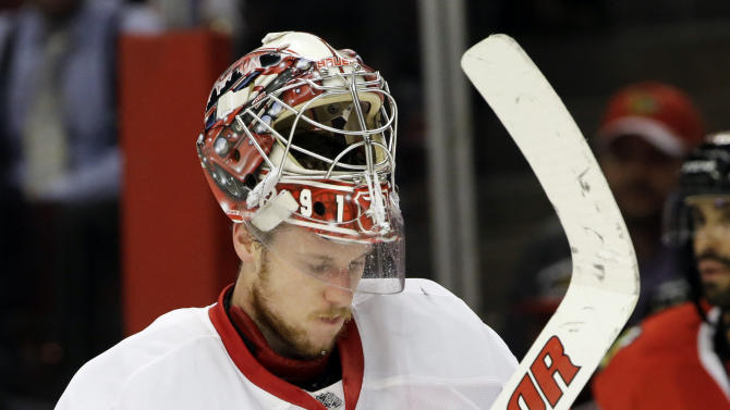 Detroit Red Wings goalie Jimmy Howard skates during the second period of Game 5 of the NHL hockey Stanley Cup playoffs Western Conference semifinals against the Chicago Blackhawks in Chicago, Saturday, May 25, 2013. (AP Photo/Nam Y. Huh)