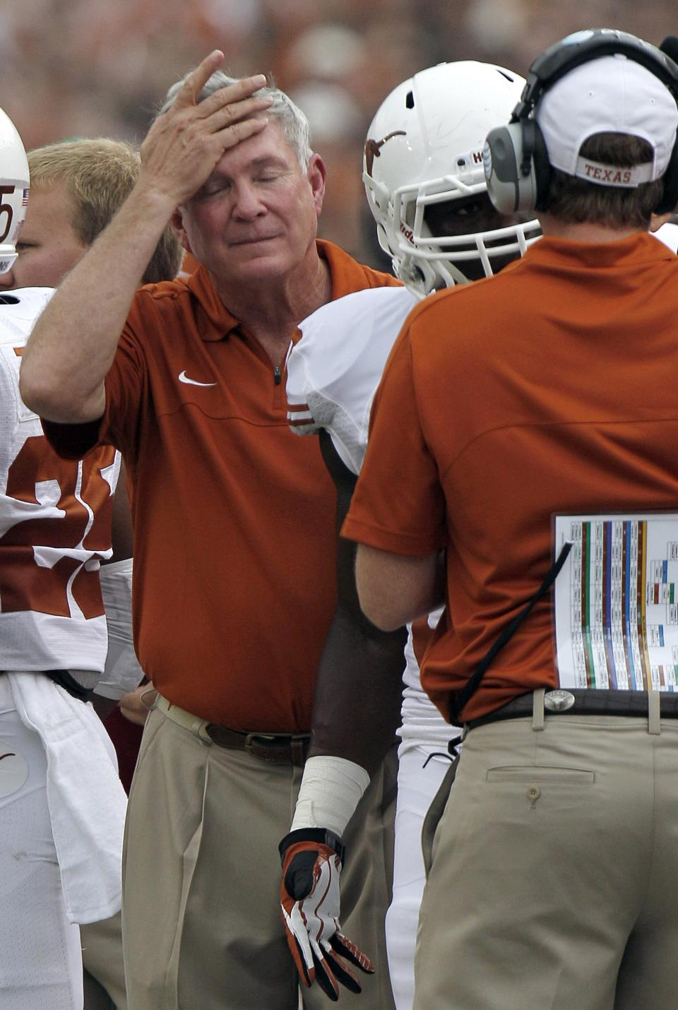 Texas head coach Mack Brown reacts after an interception during the first half of an NCAA college football game against Oklahoma at the Cotton Bowl Saturday, Oct. 13, 2012, in Dallas. (AP Photo/LM Otero)