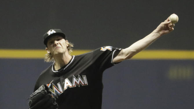 Miami Marlins starting pitcher Adam Conley throws during the seventh inning of a baseball game against the Milwaukee Brewers Friday, April 29, 2016, in Milwaukee. (AP Photo/Morry Gash)