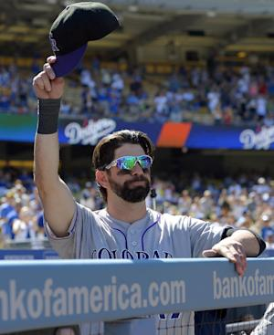 Rockies beat Dodgers 2-1 in Helton's finale
