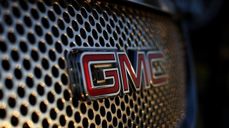A General Motors logo is seen on a Denali vehicle for sale at the GM dealership in Carlsbad