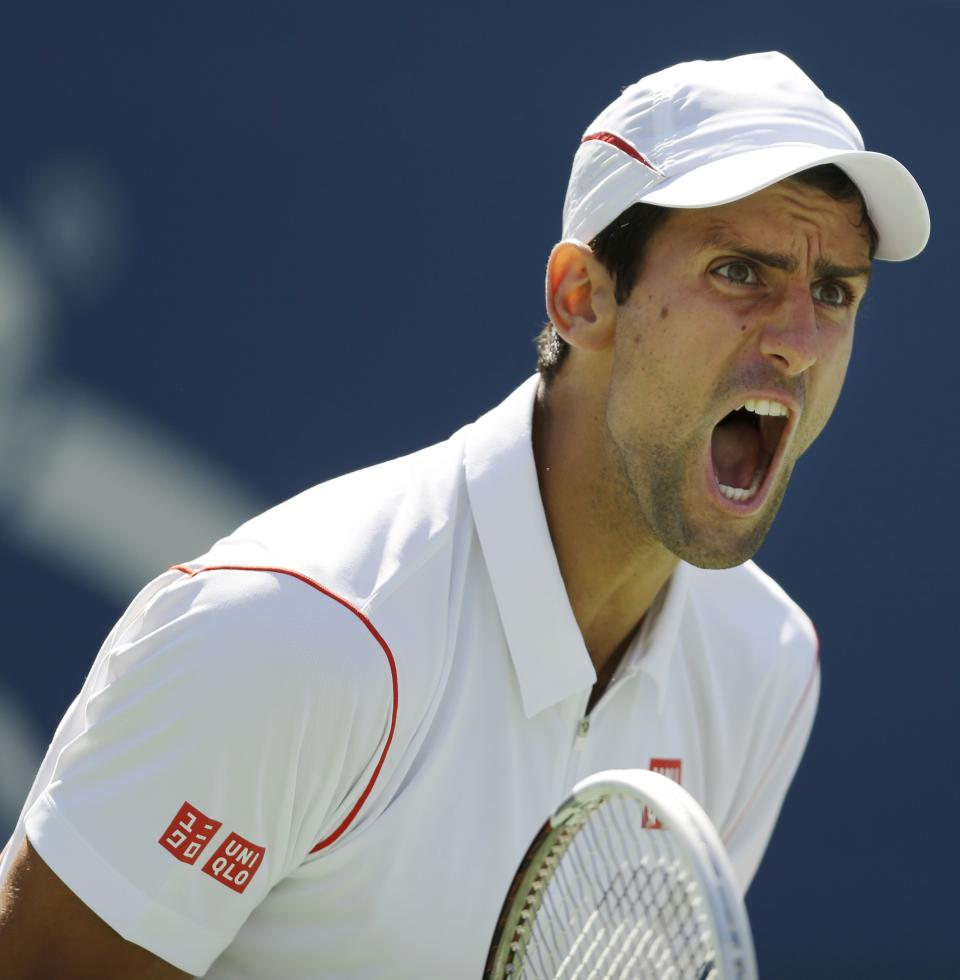 Novak Djokovic, of Serbia, reacts after a point to Stanislas Wawrinka, of Switzerland, during the semifinals of the 2013 U.S. Open tennis tournament, Saturday, Sept. 7, 2013, in New York. (AP Photo/Darron Cummings)