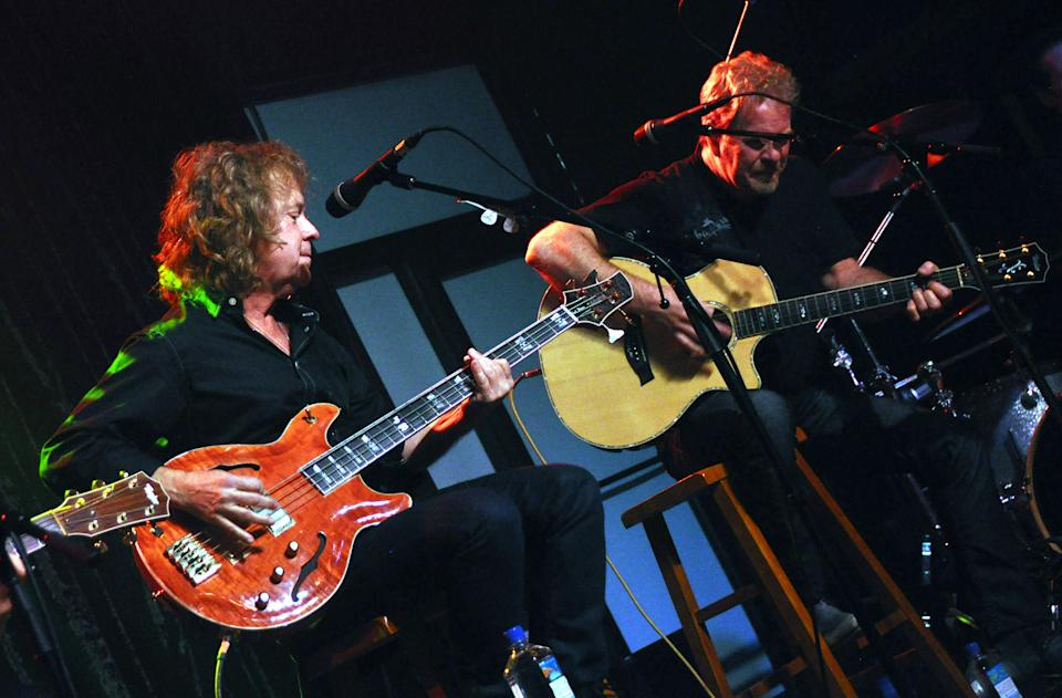 This March 26, 2013 photo shows Night Ranger singer and bassist Jack Blades, left, and guitarist Brad Gillis performing at the Brennan Rock & Roll Academy in Sioux Falls, S.D. The center will give Boys & Girls Clubs members a chance to learn guitar, bass, drums, keyboards and vocals. (AP Photo/Dirk Lammers)