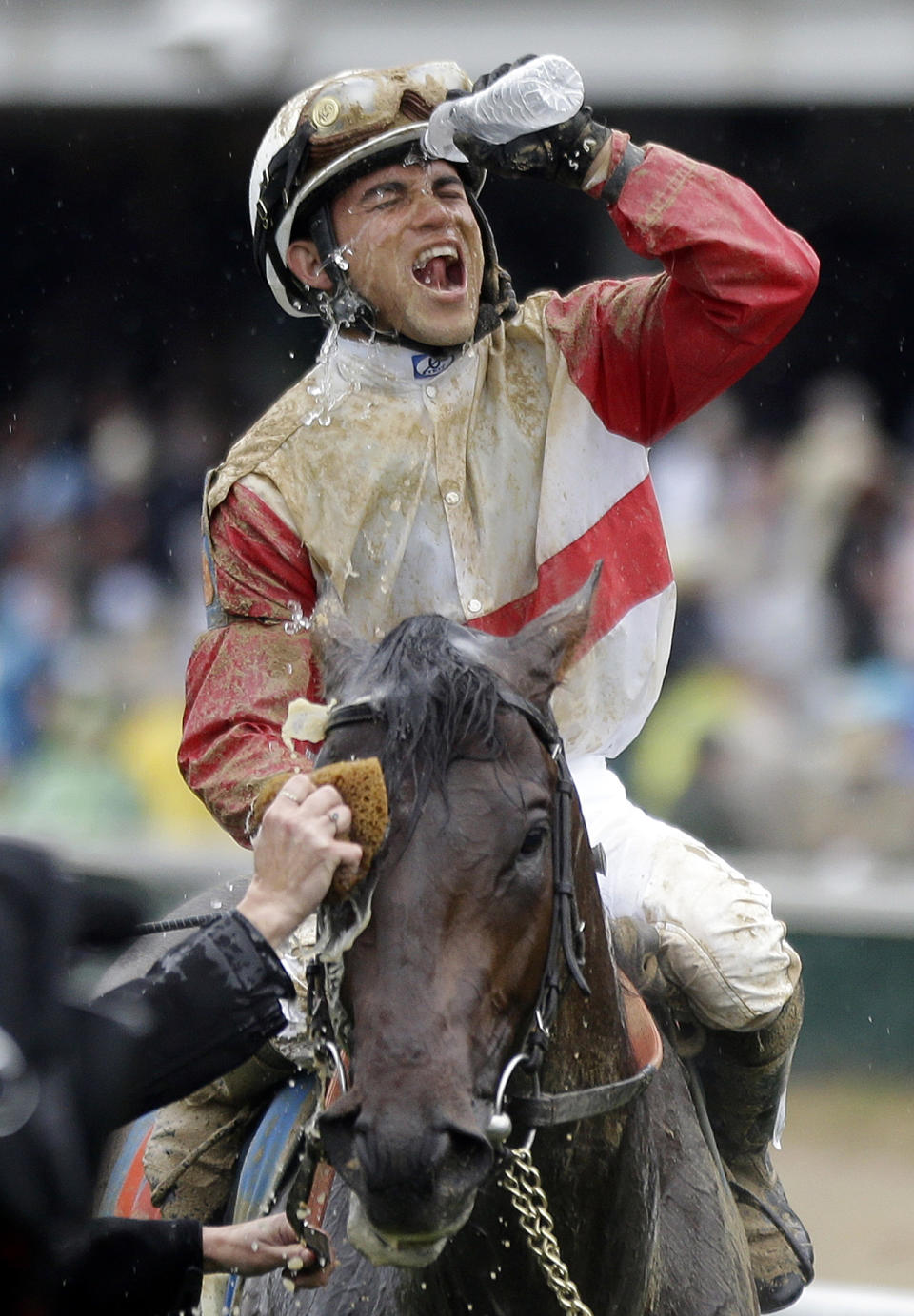 Joel Rosario celebrates after riding Orb to victory in the 139th Kentucky Derby at Churchill Downs Saturday, May 4, 2013, in Louisville, Ky. (AP Photo/David Goldman)
