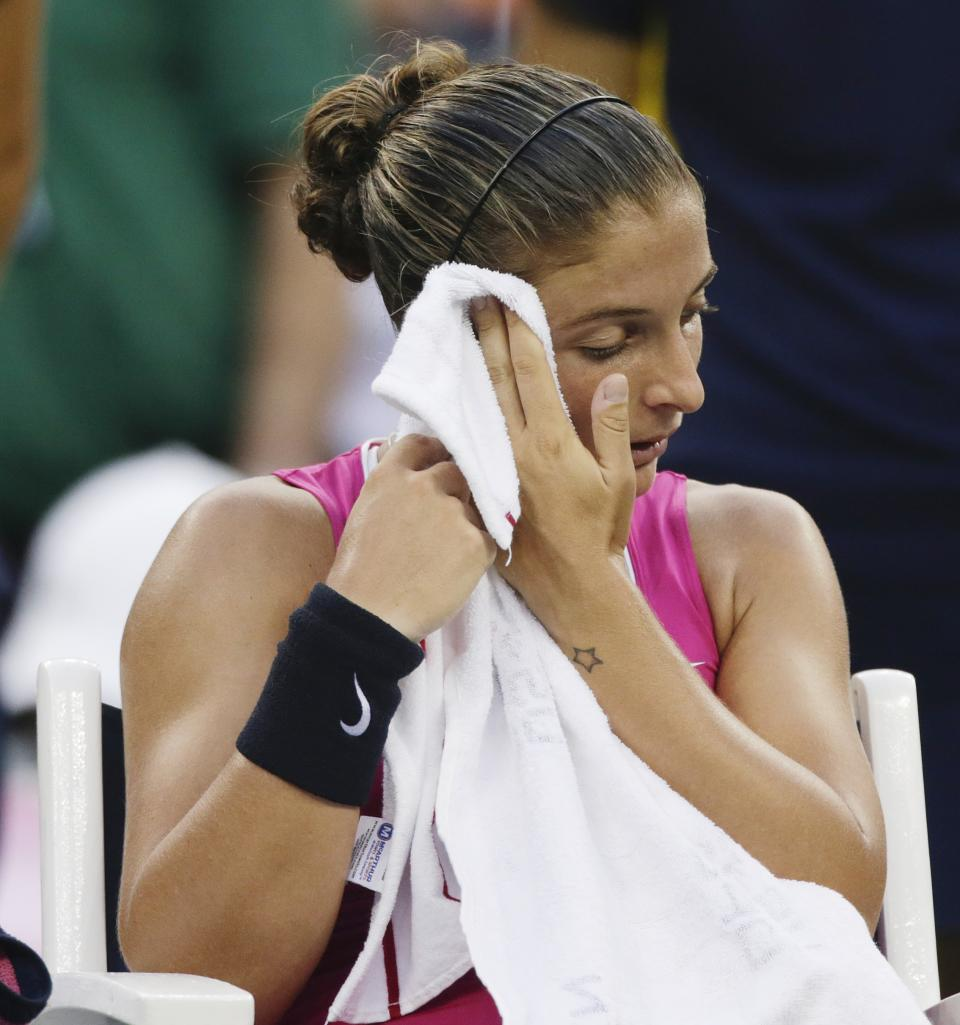 Italy's Sara Errani wipes her face during a break in her match against Serena Williams during a semifinal match at the 2012 US Open tennis tournament,  Friday, Sept. 7, 2012, in New York. (AP Photo/Charles Krupa)
