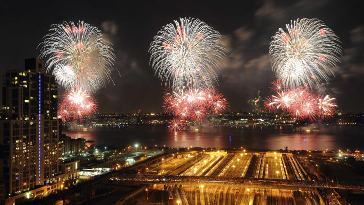 Fireworks light up the sky during the annual Macy's Fourth of July fireworks display over the Hudson River as seen from New York, Wednesday, July 4, 2012. (AP Photo/Jeffrey Furticella)