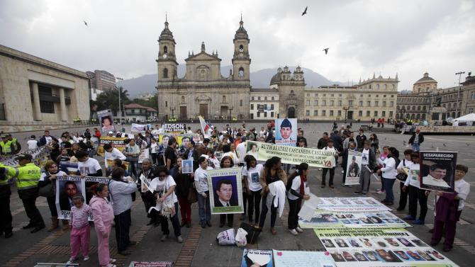 People demonstrate during a protest organized by activists and relatives of people allegedly disappeared by rebels, in Bogota, Colombia, Sunday, Oct. 14, 2012. Demonstrators demanded participation in the peace talks between Colombia's government and Colombia's main leftist rebel movement, FARC, that will start on Monday in Norway. (AP Photo/Fernando Vergara)