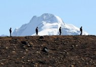 Indian Army personnel keep watch at Bumla pass on the India-China border in Arunachal Pradesh on October 21, 2012. Beijing stressed Wednesday that India and China were &quot;partners instead of rivals&quot; with common interests in development, striking a conciliatory note on the 50th anniversary of a war between the neighbours