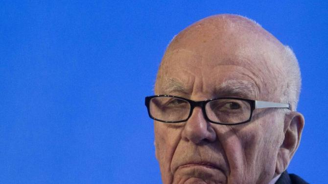 File of Murdoch, executive chairman of News Corporation, reacts during a panel discussion at the B20 meeting of company CEOs in Sydney