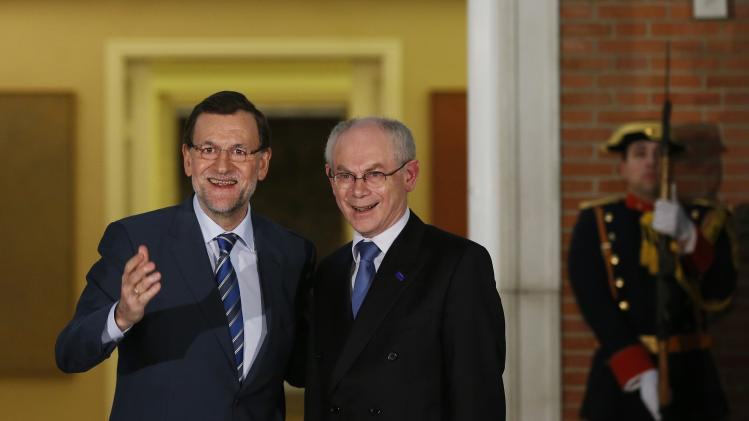 Spain's PM Rajoy and European Council President Van Rompuy pose before their meeting at Madrid's Moncloa Palace