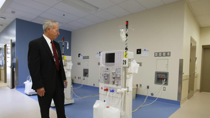 Jeffrey Beard, secretary of the California Department of Corrections and Rehabilitation, looks over a dialysis machine while touring the new California Correctional Health Care Facility in Stockton, Calif., Tuesday, June 25, 2013. The $839 million facility will treat up to 1, 720 inmate-patients in need of long-term care, freeing up staff and treatment space at the state's 33 adult prisons. The facility will begin receiving inmates in July. (AP Photo/Rich Pedroncelli)