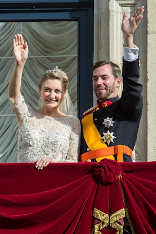 Luxembourg's Prince Guillaume and Countess Stephanie wave from the balcony of the Royal Palace after their wedding in Luxembourg, Saturday, Oct. 20, 2012. (AP Photo/Geert vanden Wijngaert)