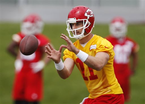 Kansas City Chiefs quarterback Alex Smith (11) takes a snap during NFL football camp at the teams practice facility in Kansas City, Mo., Wednesday, May 22, 2013