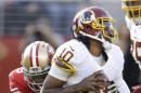 Washington Redskins quarterback Robert Griffin III (10) is sacked by San Francisco 49ers linebacker Aldon Smith during the first quarter of an NFL football game in Santa Clara, Calif., Sunday, Nov. 23, 2014. (AP Photo/Ben Margot)