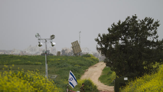 An Israeli soldier stands guard near the Israeli anti-missile system known as Iron Dome deployed in order to intercept rockets fired by Palestinian militants from the Gaza Strip in the city of Ashdod, southern Israel, Monday, March 12, 2012. The Israeli military said it carried out nine air attacks against rocket-launching sites and a weapons storage facility early Monday. (AP Photo/Ariel Schalit)