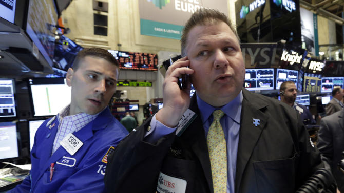 Specialist Joseph Mastrolia, left, and trader George Ettinger work on the floor of the New York Stock Exchange, Friday, June 21, 2013. U.S. stocks rose in morning trading on Friday as traders regrouped following the biggest drop of the year. (AP Photo/Richard Drew)