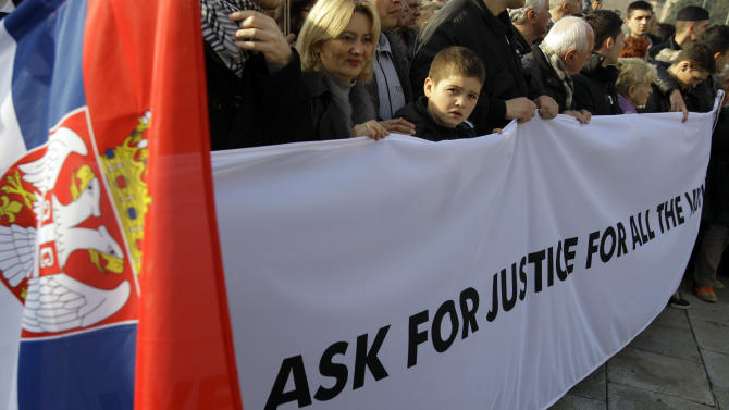 """Protesters carrying a banner that reads: """"We ask for justice for all the victims"""" during protest march against the Hague  war crimes tribunal, in Belgrade, Serbia, Sunday, Nov. 25, 2012. Serbia is furious that the appeals judges at the war crimes court in the  Hague  last Friday freed  Croat generals Ante Gotovina and Mladen Markac, who previously had been sentenced to lengthy prison terms for crimes against Serbs. (AP Photo/Darko Vojinovic)"""
