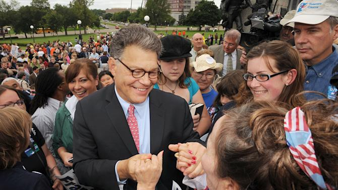 FILE - This July 1, 2009 photo shows Sen.-elect Al Franken, D-Minn., shaking hands with supporters during a rally at the Minnesota State Capitol in St Paul, Minn. Sen. Franken won his first term in 2008 only after a months-long recount in which he barely squeaked through. But Franken has transformed his upcoming re-election race into one that many national Republicans are writing off, choosing to focus their money instead on more vulnerable Democrats. He's done it in part by transforming his image from the wisecracking former Saturday Night Live start into quiet policy wonk. (AP Photo/Craig Lassig)