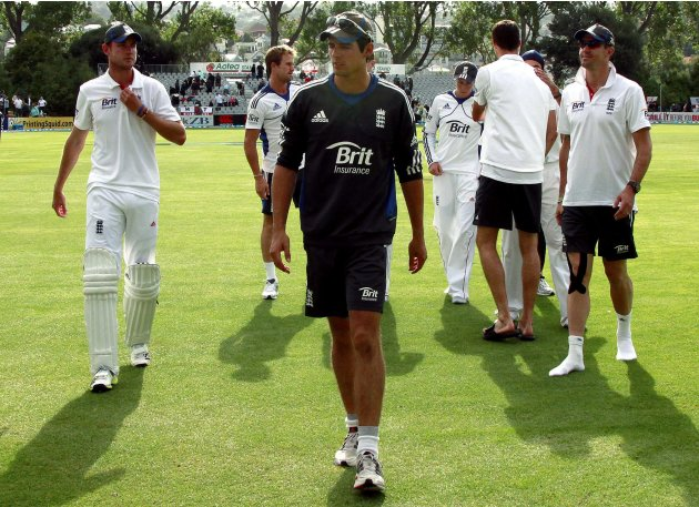 England team captain Alastair Cook leads members of his team off the ground at the end of the first test against New Zealand at the University Oval in Dunedin