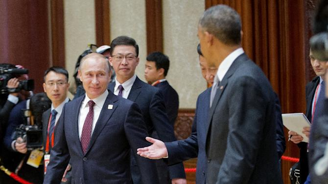 Russian President Vladimir Putin (L) Chinese President Xi Jinping (C) and US President Barack Obama are seen arriving at the the Asia-Pacific Economic Cooperation Summit in 2014