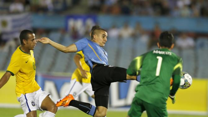 Uruguay's Arambarri tries to score under pressure from Brazil's Evangelista and Marcos during their South American Under-20 Championship final round soccer match in Montevideo